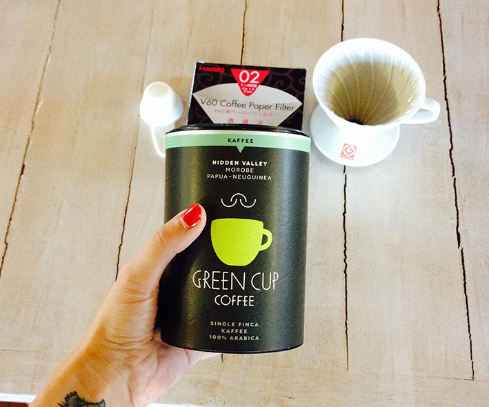 green_cup_coffee_hand
